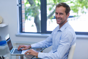 Man developing SEO strategies for dental practices
